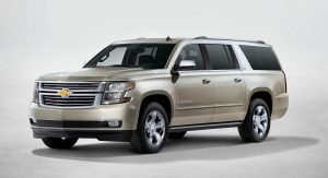 2015 Chevrolet Suburban in Champagne side view from New York reveal
