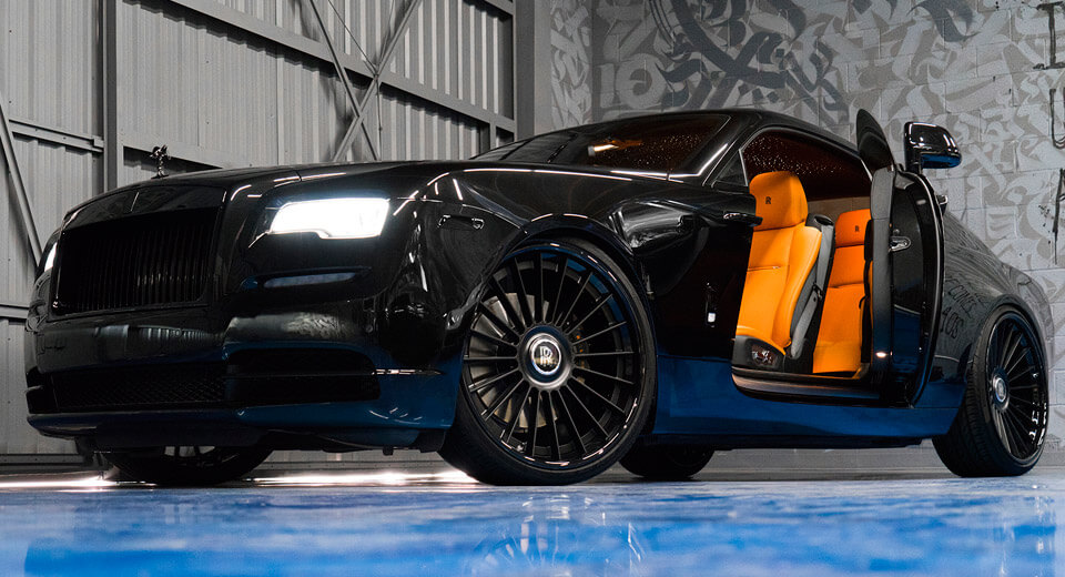 murdered-out rolls-royce wraith keeps the party on the inside