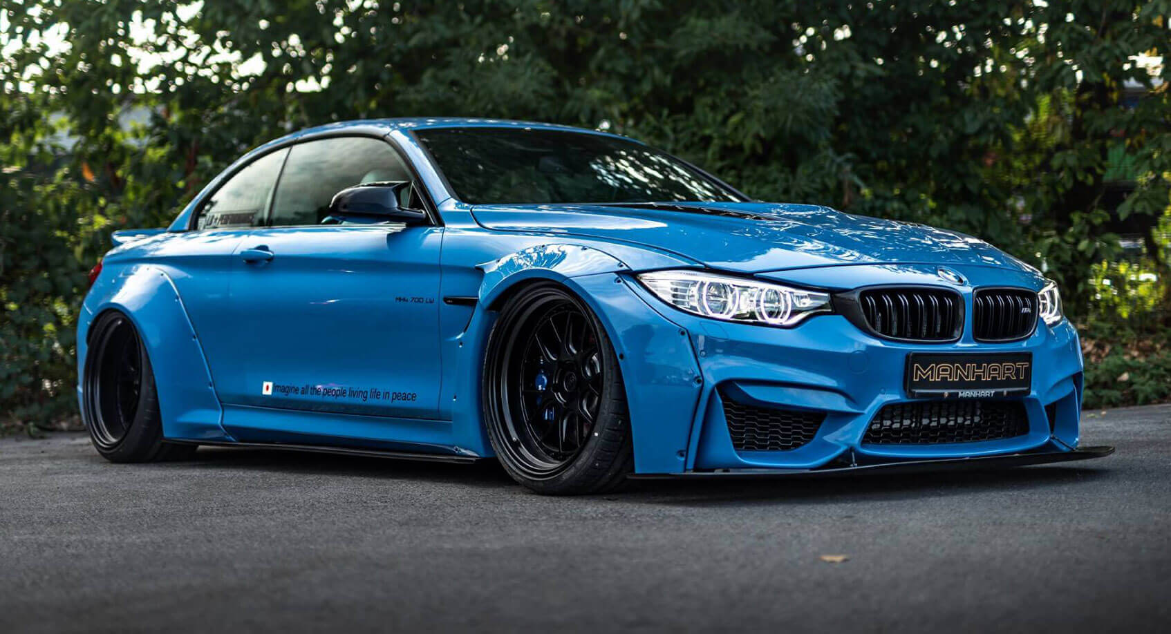 manhart s bmw m4 convertible mixes ott looks with 690 hp carscoops. Black Bedroom Furniture Sets. Home Design Ideas