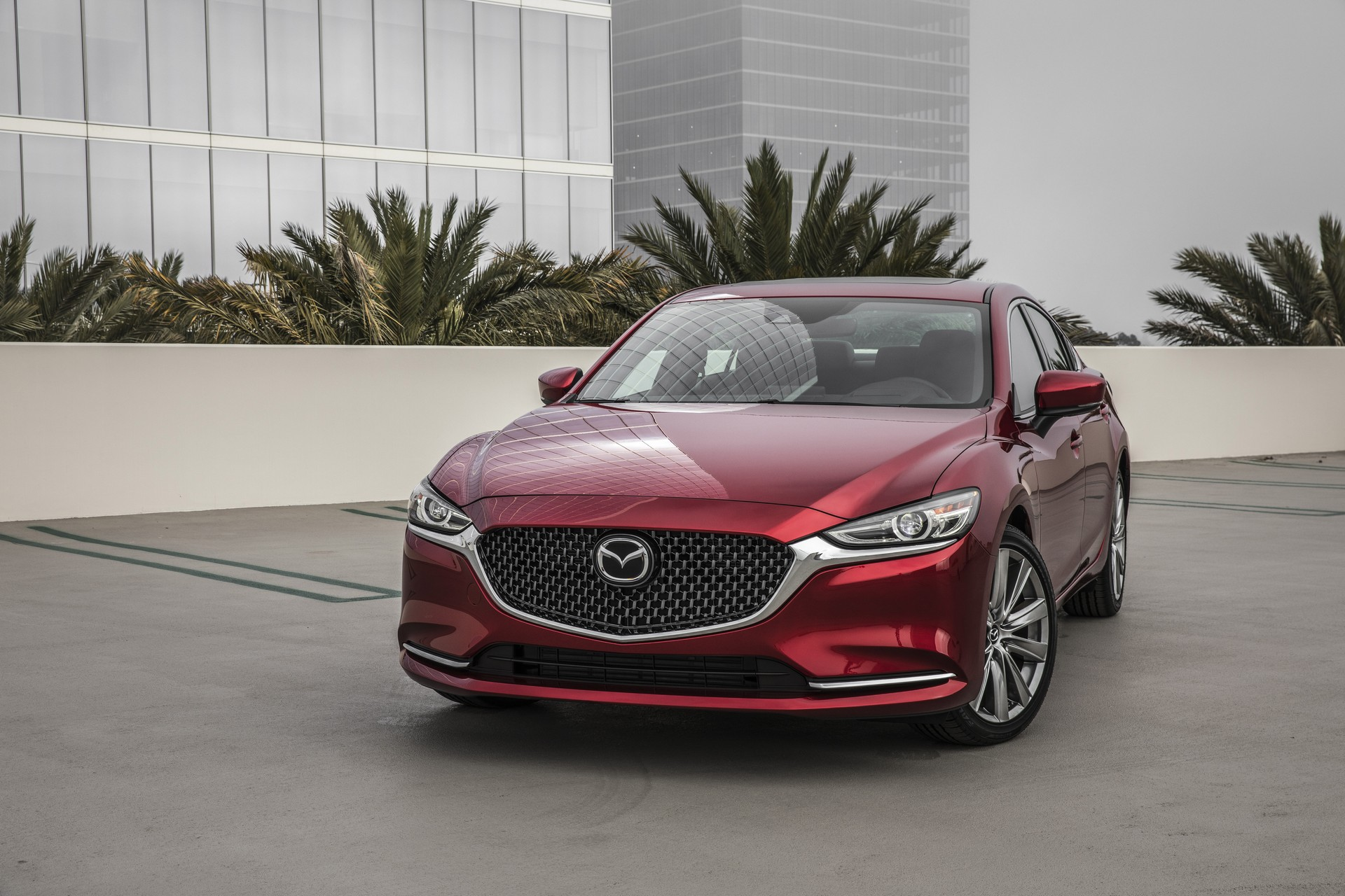 besides the upgraded engine the mazda6 grand touring has beefier brakes an auto dimming rearview mirror and steering wheel mounted paddle shifters