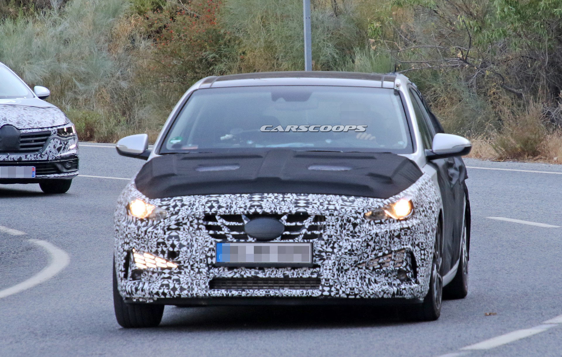 2021 hyundai i30 shows its new face in latest spy photos